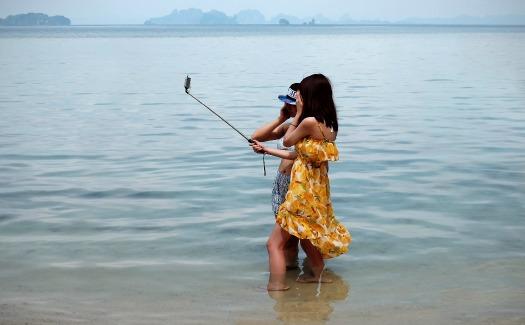 Selfie stick in ocean
